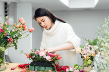 Young Asian Girls Making Flower Arrangement