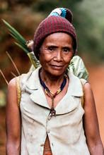 Elderly Female Farmer Walking Along Road