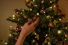 Woman Decorates Christmas Tree