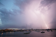 Lightning Strikes Behind Parked Sailboats