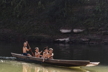Asian Kids Paddling On Boat In...