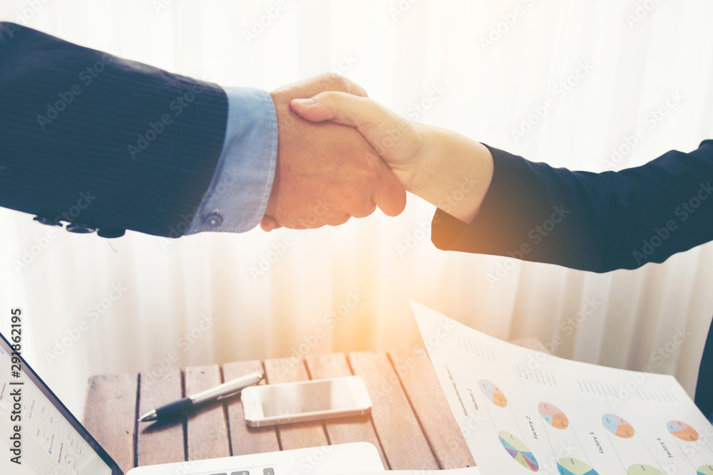 Fototapety, obrazy: Agreement business handshake of two businessman shaking hands.