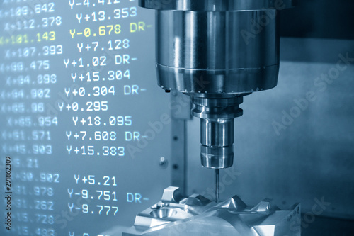 Obraz The abstract scene of the G-code data background and the CNC milling machine cutting the mould and die parts with solid ball endmill tools.Hi-precision  mold  production process by machining center. - fototapety do salonu