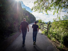 Father And Son Walking Together From Behind On Snake River Rim Trail Near Shoshone Falls Park, Twin Falls, Idaho, USA