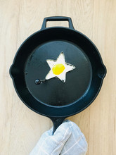 Fried Egg In Star Shaped Cutter On Cast Iron Pan