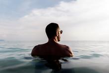 Smiling Man Swimming In Sea Water