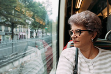 Senior Woman Looking Out Of The Subway Window