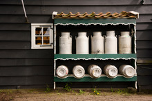 Milk Bucket In Shelf Against H...
