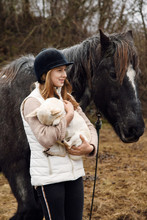 Lady With Funny Dog Near Horse In Countryside