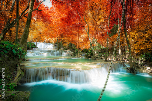 Fototapeta Amazing in nature, beautiful waterfall at colorful autumn forest in fall season obraz na płótnie