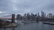 skyline of lower manhattan and brooklyn bridge in