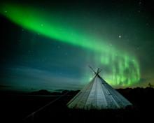 Aurora Borealis (Northern Lights) Over A Traditional Lavvu, Senja