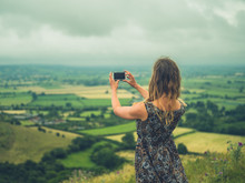 Young Woman Taking Photos With...