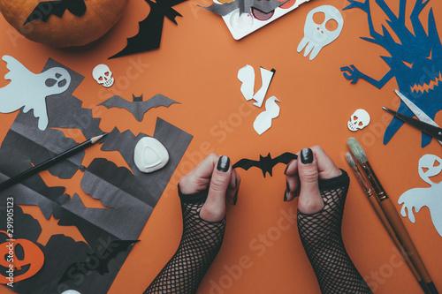 Image of halloween backgrounds with paper ghosts, pumpkin, skulls, human hands Wallpaper Mural