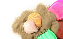 Beach Toys For Kids, Plastic Tools In Sand Pile With Seashells Isolated On White Background, Top View