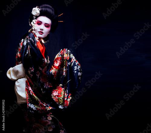 geisha in kimono on black Wallpaper Mural