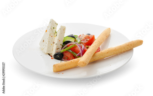 Plate with tasty Greek salad on white background
