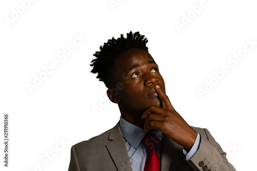 Young businessman looking up Fototapet