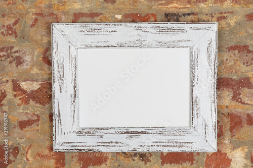 Foto op Plexiglas Historisch geb. Blank framed picture on a wall
