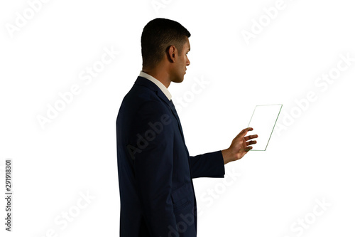 Businessman holding a transparent portable device