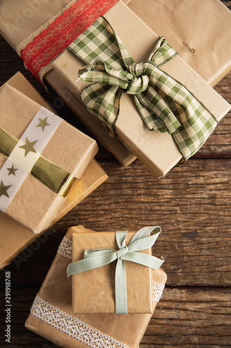 Simple wrapped gift on wooden table