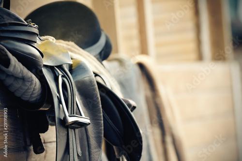 Black sports saddle. Horse ammunition.