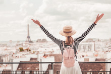 Happy Asian Girl Enjoys A Grand View Of Paris From The Height Of The Observation Deck