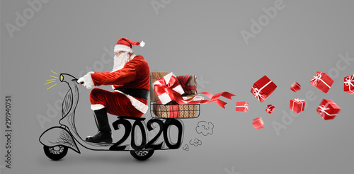Santa Claus on scooter delivering Christmas or New Year 2020 gifts at snowy gray Canvas