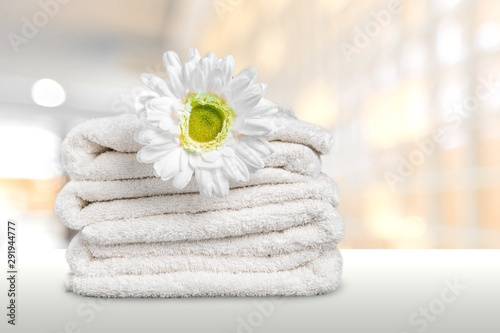 Laundry Basket with colorful towels on background Fototapeta