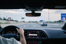 Man Driving A Car On Road