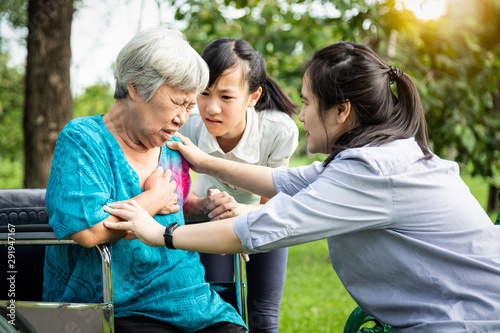 Asian senior having panic disorder suffering an anxiety attack with the hands in ,mental health problem,depressed elderly woman having heartbeats fast,heart palpitation,shortness of breath at park
