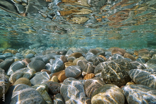 Pebbles stone under water surface natural scene #291948919