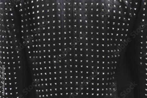 Fotografie, Obraz Back of a black leather jacket with metal rivets
