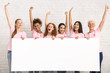 canvas print picture - Ladies In Breast Cancer Awareness T-Shirts Holding Blank Board Indoor