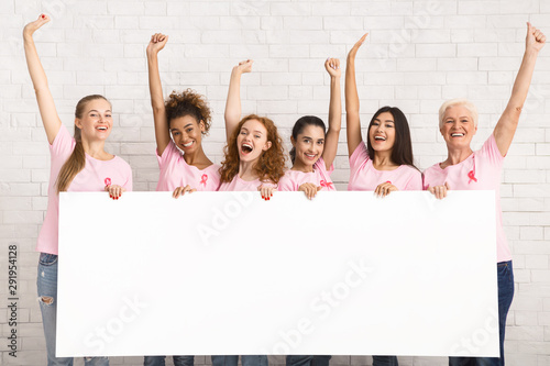 Wall Murals Equestrian Ladies In Breast Cancer Awareness T-Shirts Holding Blank Board Indoor