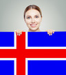 canvas print picture - Iceland concept. Happy woman with the Icelandic flag background.