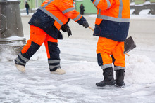 Communal Services Workers Sweep Snow From Road In Winter, Cleaning City Streets And Roads After Snow Storm. Moscow, Russia.
