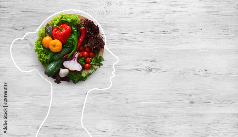 Fototapeta Fresh vegetables in woman head symbolizing health nutrition
