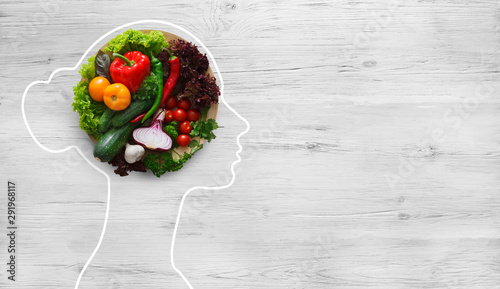 Carta da parati  Fresh vegetables in woman head symbolizing health nutrition