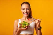 Fitness Girl Eating Vegetable ...