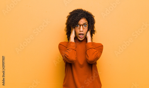 young pretty black woman looking unpleasantly shocked, scared or worried, mouth Canvas Print
