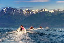 Coastal Exploration By Zodiac. Icy Strait Point, Alaska. Excursion By Motor Boat. Four Boats With Amazing View On Snow Mountains. Blue Water And Green Hills.