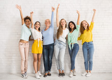 Diverse Women Waving Hands Standing Against White Wall Indoor