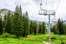 Albion Basin, Utah Summer With Ski Lift Chairs On Cables And Cloudy Sky In Rocky Wasatch Mountains On Trail