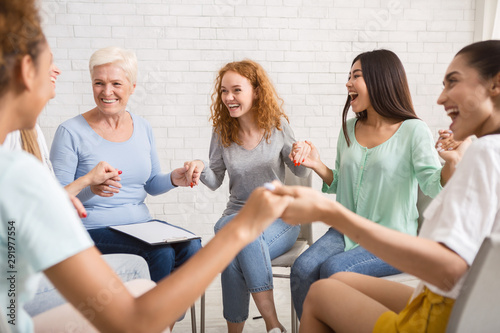 Obraz Smiling Diverse Women Sitting In Circle During Group Therapy Indoor - fototapety do salonu