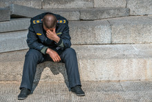 Sad Policeman Is Sitting On Th...