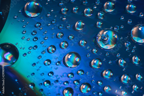 Obraz Close up colored water drops on a cd dvd disk background. - fototapety do salonu