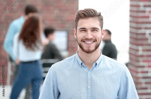 Portrait of confident businessman in office.