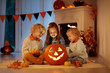 canvas print picture Kids carving pumpkin on Halloween. Trick or treat.