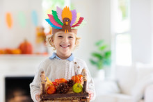 Child On Thanksgiving. Kid Wit...